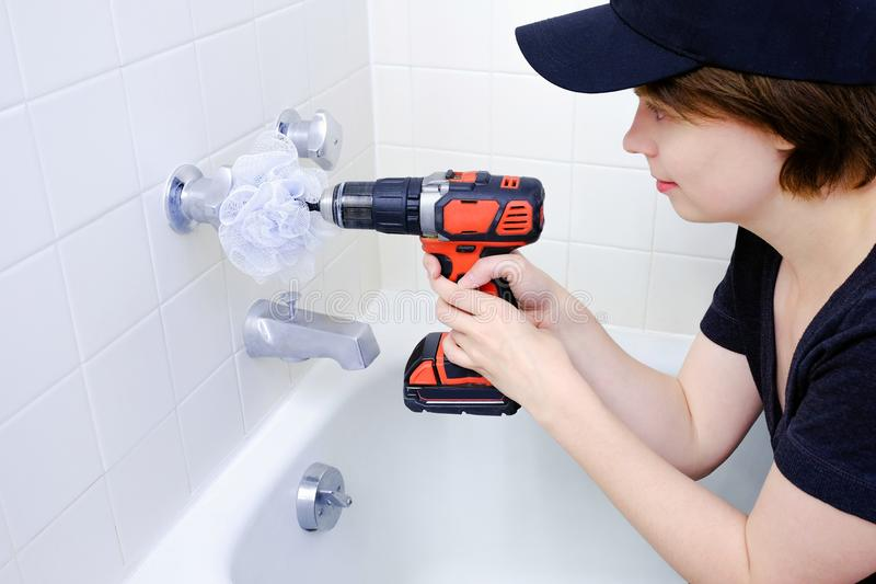 Woman cleaning a shower or bath royalty free stock image