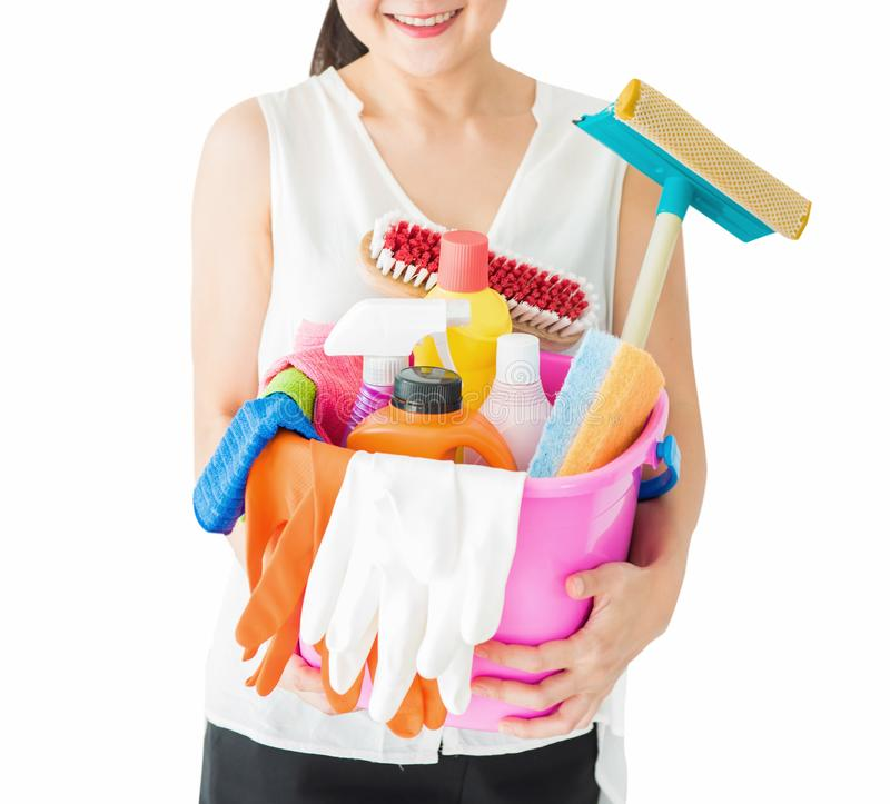 Woman with cleaning supplies and detergents stock photo