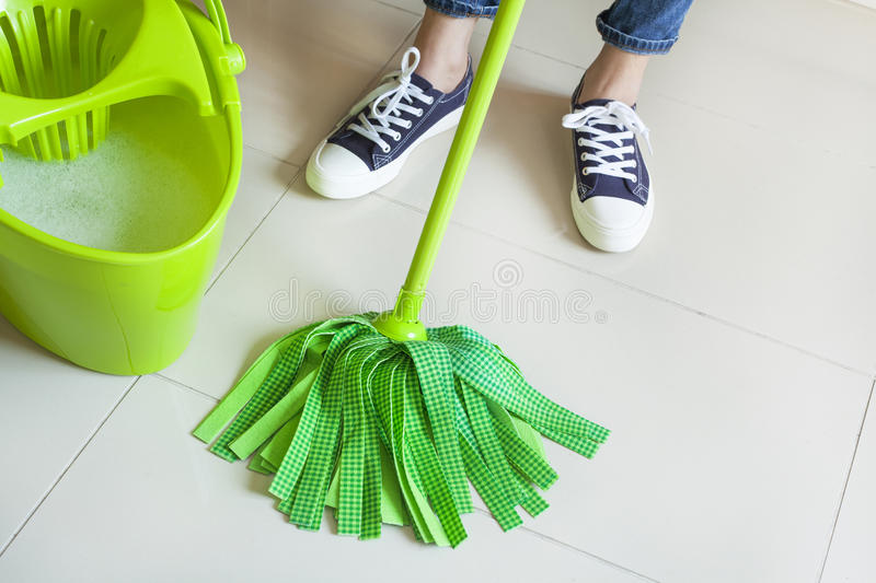 Woman with cleaning supplies in home stock photography