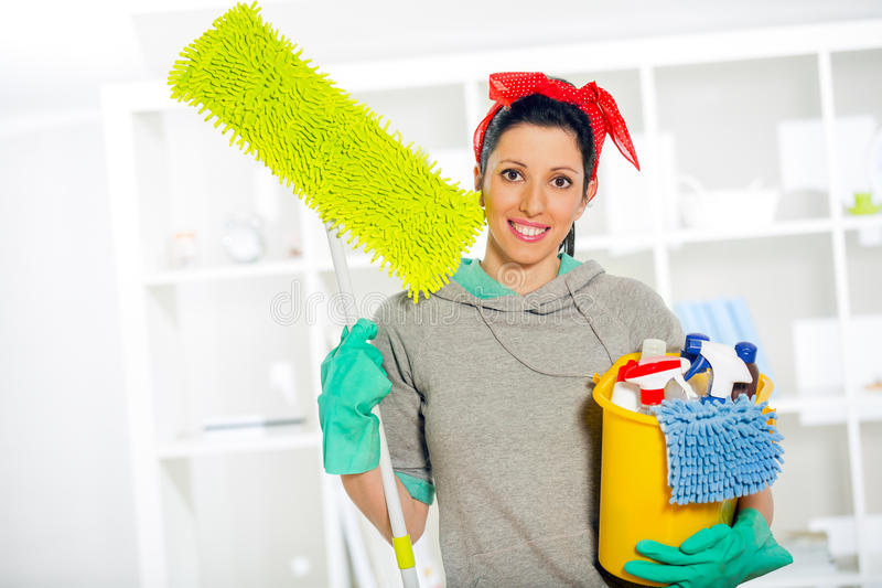 Woman with cleaning supplies. Young Woman with cleaning supplies stock photos