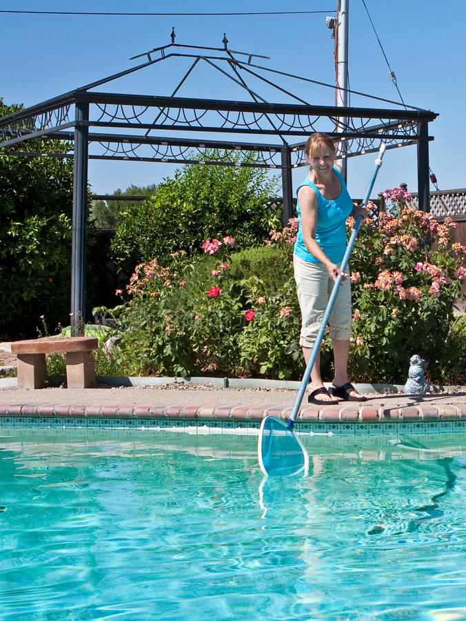 Download Woman Cleaning Swimming Pool Stock Photo - Image of water, pants: 14943974