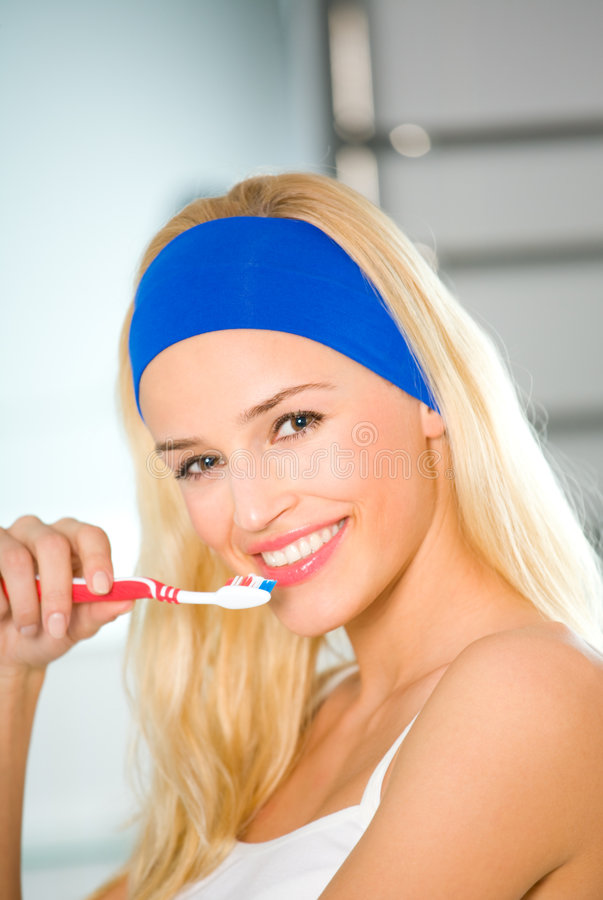Free Woman Cleaning Teeth Royalty Free Stock Images - 4326059