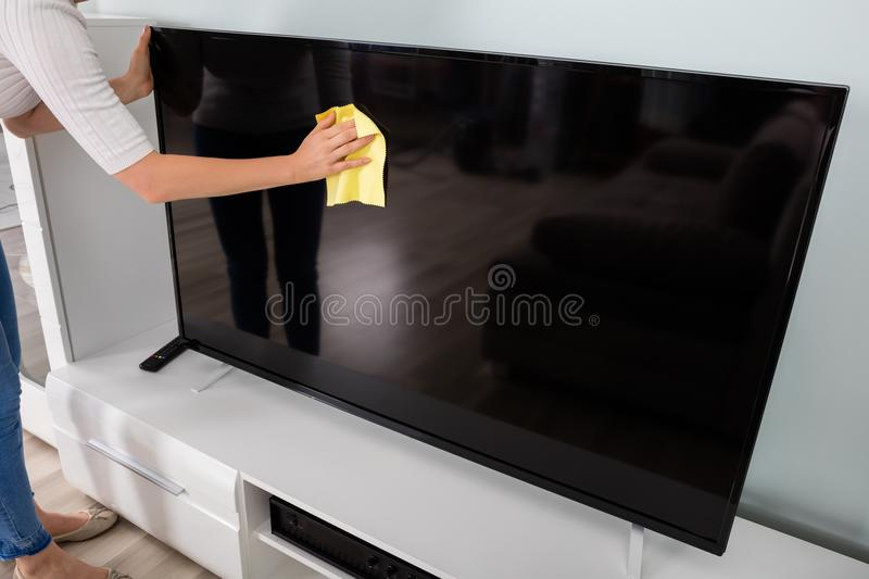 Woman Cleaning Television stock photo
