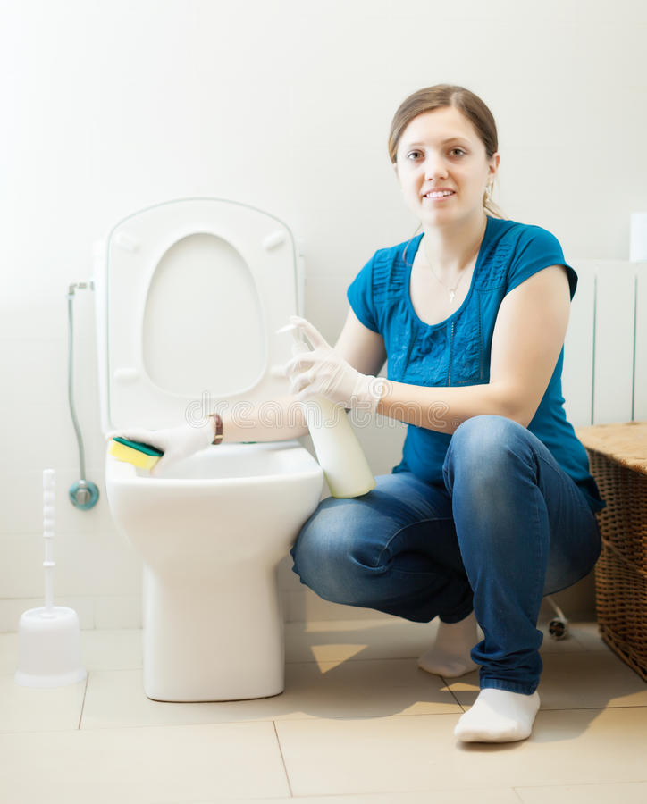Download Woman Cleaning Toilet Bowl With Sponge And Cleaner Stock Photo