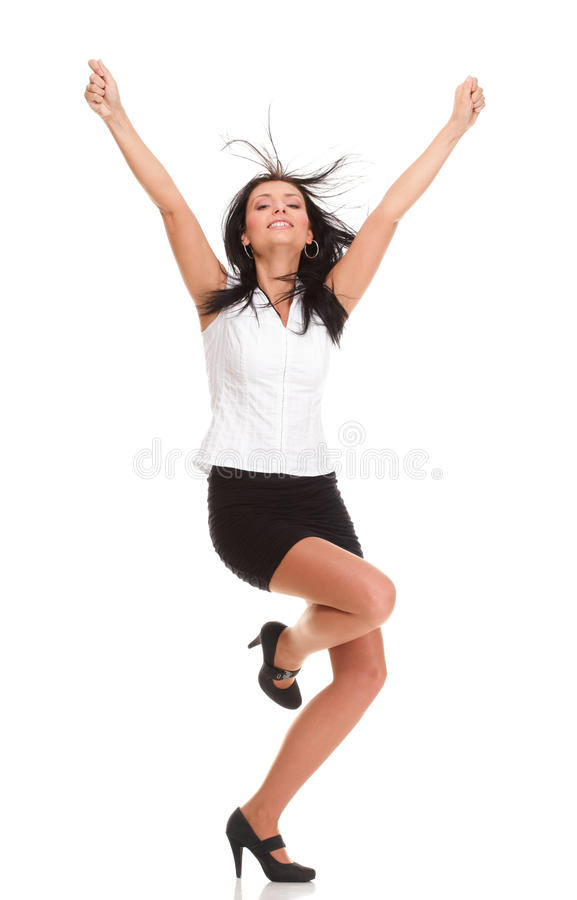 Woman clenching arms in excitement