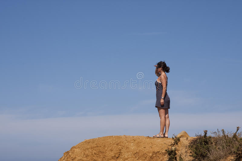Woman at the cliff stock photo