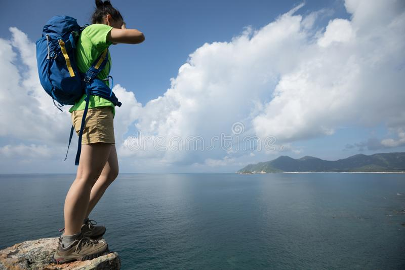 Woman on a cliff edge. With the eyes covered stock images
