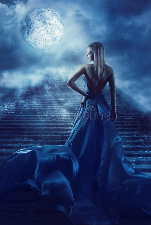 Woman Climb Up Stairs to Fantasy Moon Heaven, Fairy Night Girl. Woman Climb Up Stairs to Fantasy Moon Heaven, Fairy Girl in Night Blue Dress, Model Back View stock photo