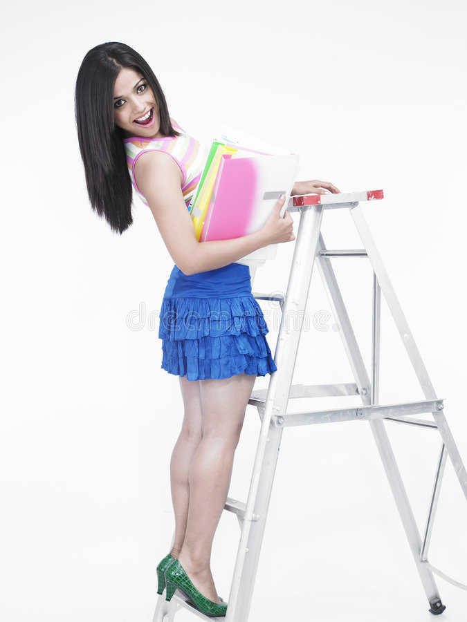 Download Woman climbing a ladder stock photo. Image of blue, female - 6818500