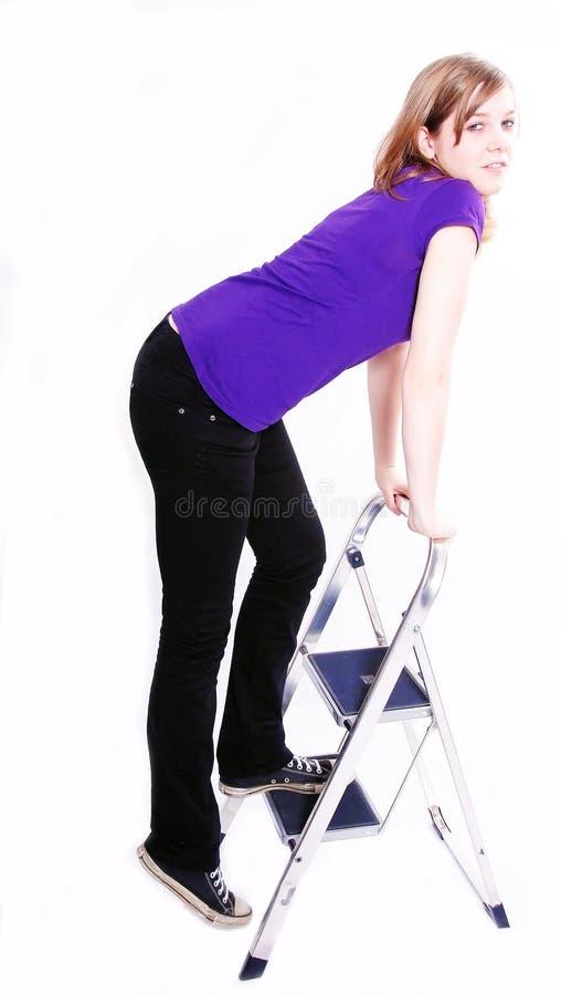 Woman Climbing A Ladder Royalty Free Stock Image
