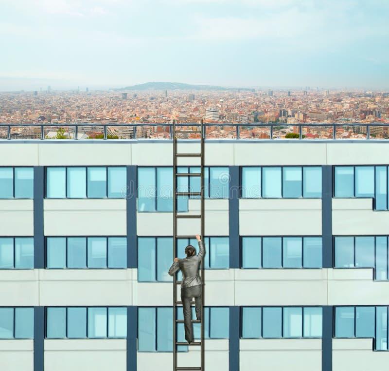 Woman climbing the ladder stock photos