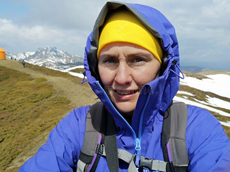 Woman climbing  mountains royalty free stock photography