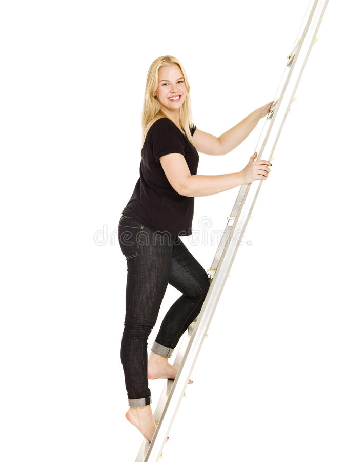 Woman climbing up the ladder stock image