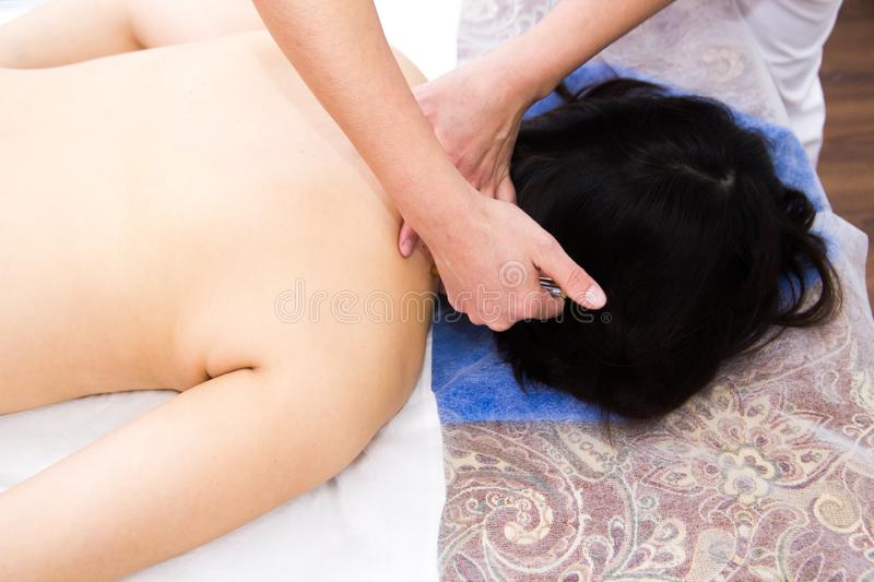 A woman in a clinic receiving a neck massage. Upper view royalty free stock photography