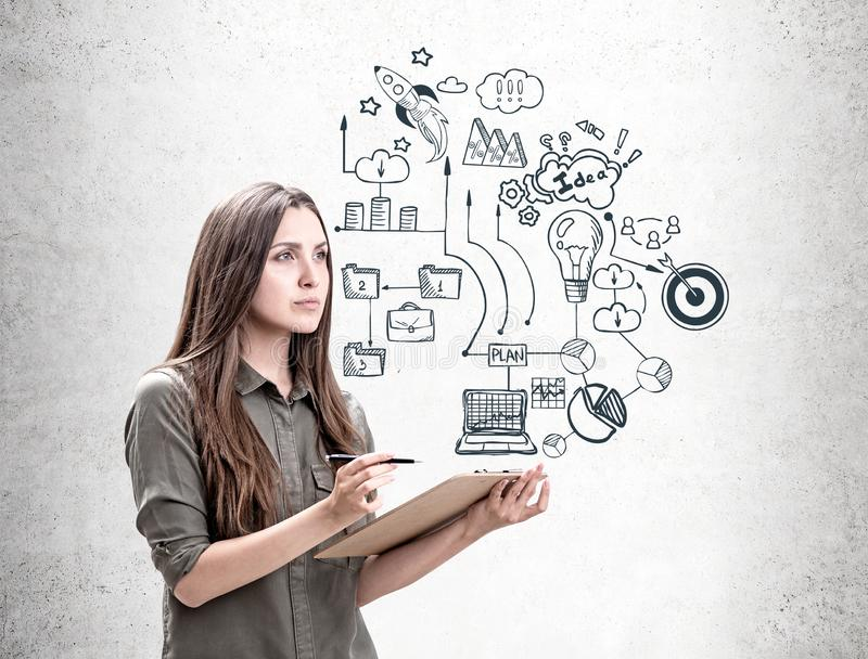 Woman with clipboard, business plan royalty free stock photo