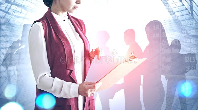 Woman with clipboard in city, business team royalty free stock photo
