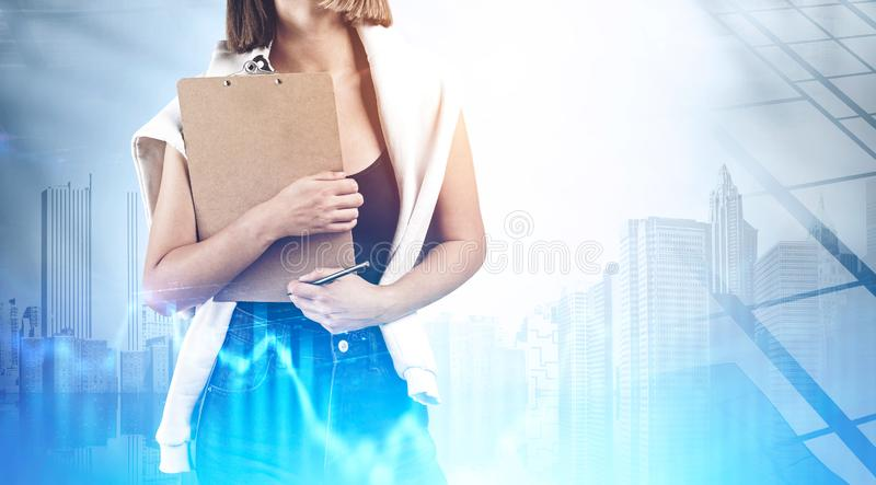 Woman with clipboard in city, digital graph royalty free stock image