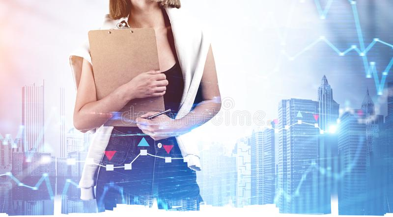 Woman with clipboard in city, forex graph royalty free stock images