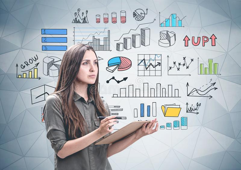 Woman with clipboard, colorful graphs royalty free stock images