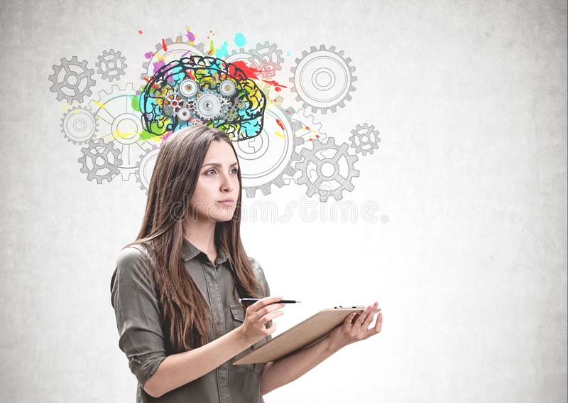 Woman with clipboard, gear brain sketch royalty free stock photography