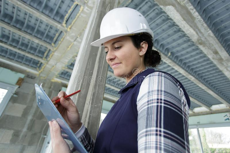 Woman with clipboard in hands stock photos