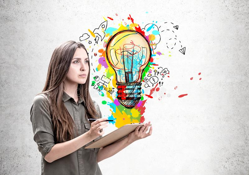 Woman with clipboard and her idea stock photo