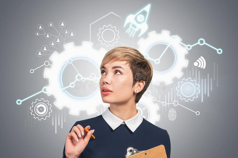 Woman with clipboard and startup project stock photography