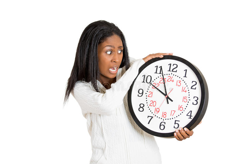 Woman with clock anxious, pressured by lack of time. Closeup portrait woman, worker, holding clock looking anxiously, pressured by lack, running out of time royalty free stock images