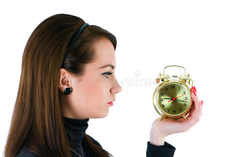 Woman with clock isolated. On the white stock photography