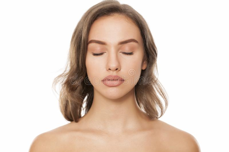 Woman with closed eyes stock photos