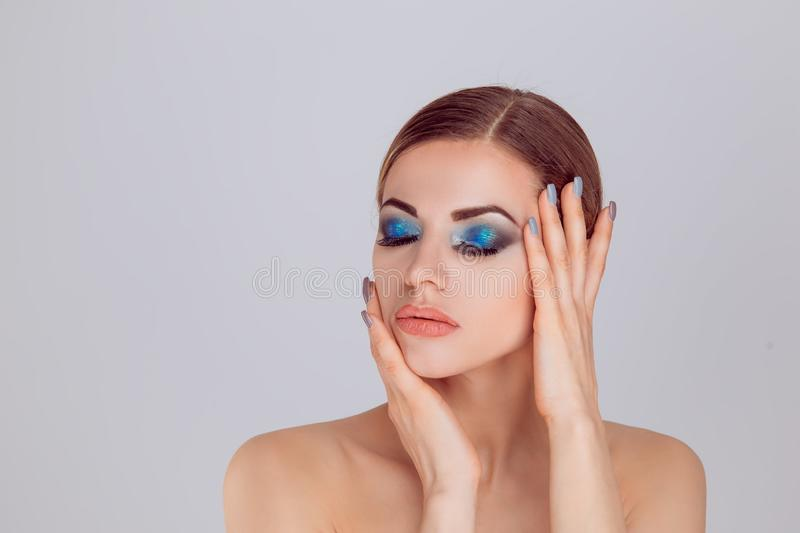 Woman with closed eyes posing showing perfect makeup royalty free stock photos