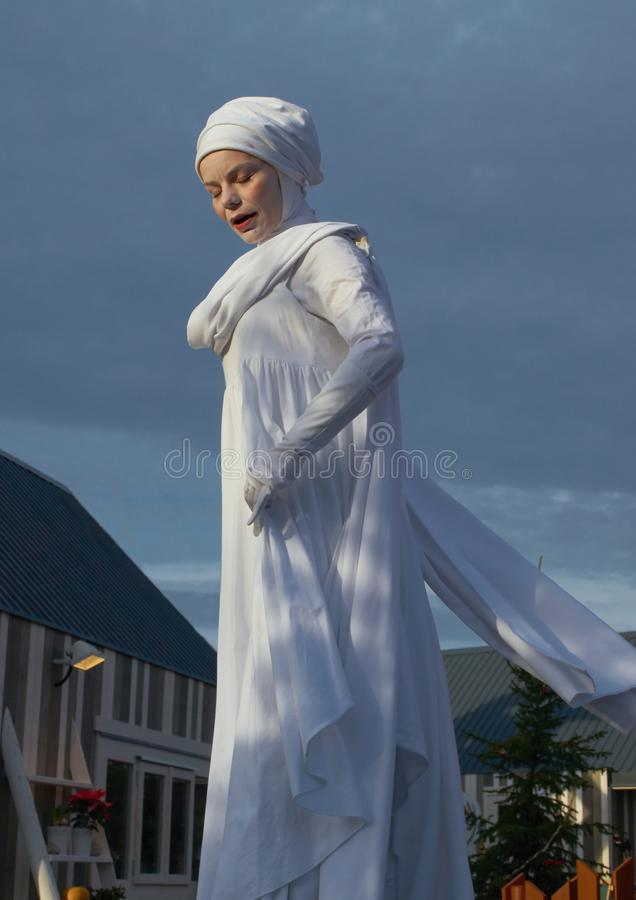 A woman with closed eyes in robe of Saint Lucia royalty free stock image