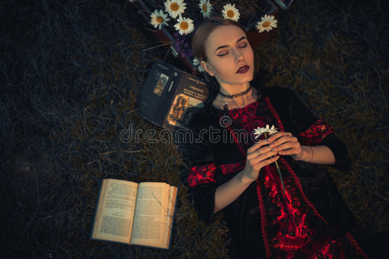 Woman closes her eyes and meditates. stock photography