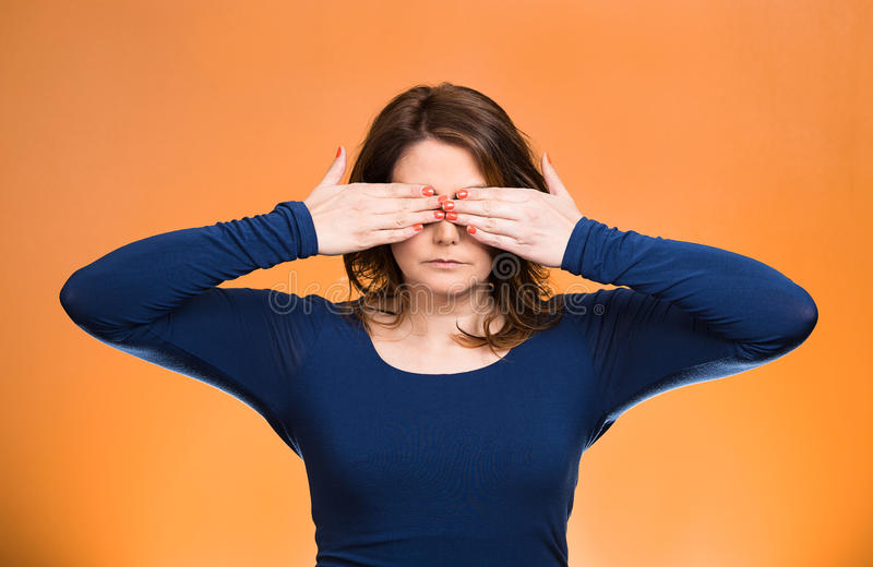 Woman, closing, covering eyes with hands can't look, hiding. See no evil concept stock photography