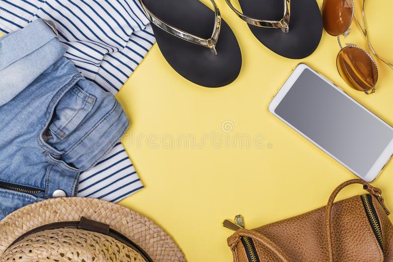 Woman clothes accessories set. Woman fashion clothes and accessories set. Summer sale concept on yellow background. Copy space royalty free stock photo