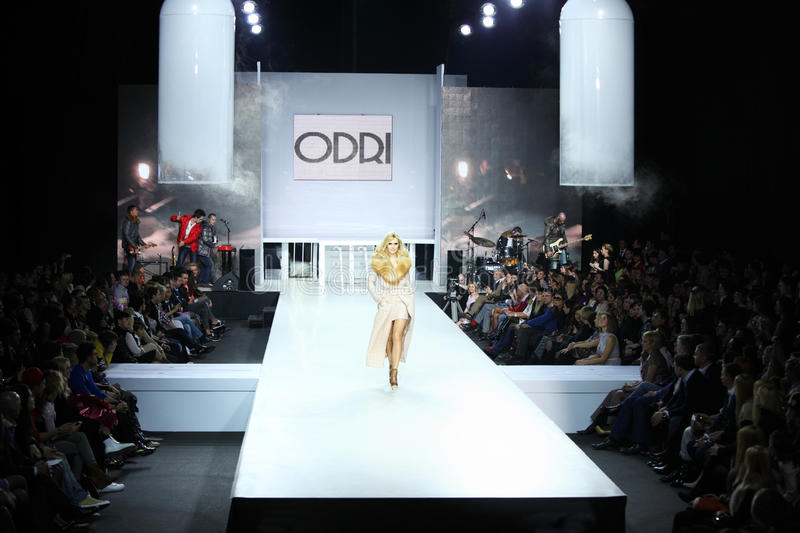 Woman in clothes from ODRI at Volvo Fashion Week stock image