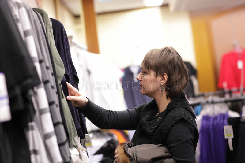 Download Woman in clothes shop stock photo. Image of beauty, display - 18788394