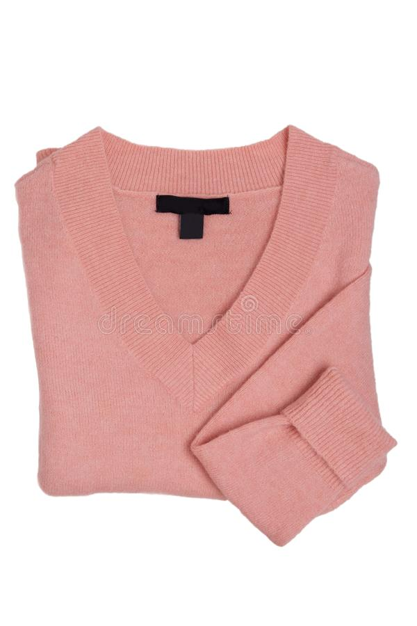 Woman clothes sweater isolated. Close-up of a folded female pink cashmere sweater or light wool pullover isolated on a white. Background. Fashion for woman royalty free stock photography
