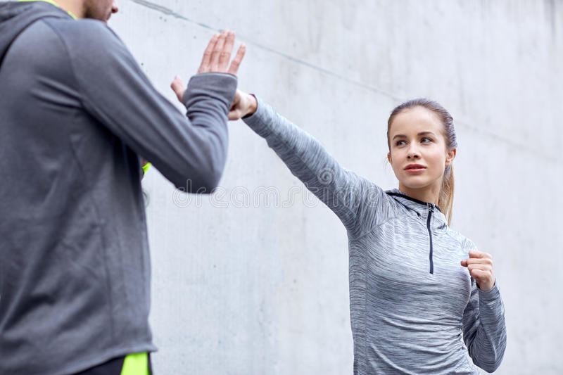 Woman with coach working out strike outdoors royalty free stock photos