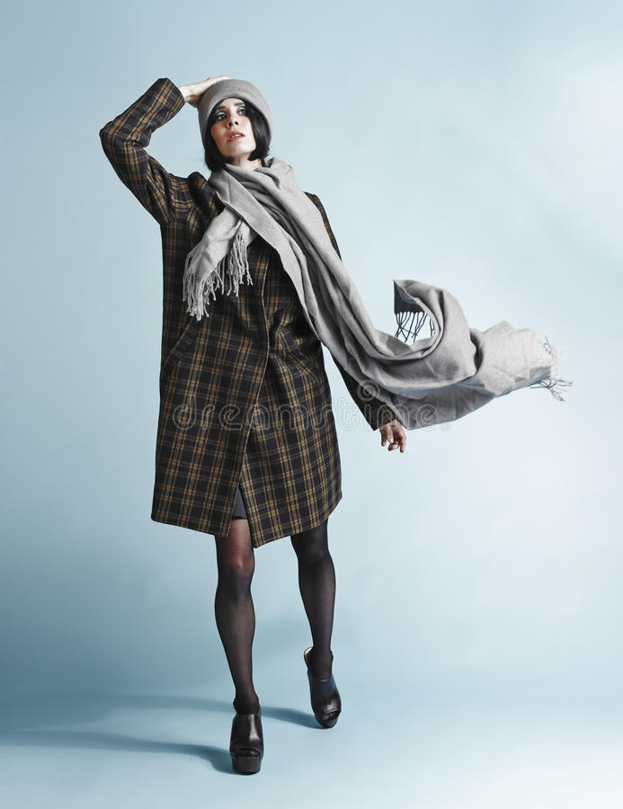 Woman and coat royalty free stock images