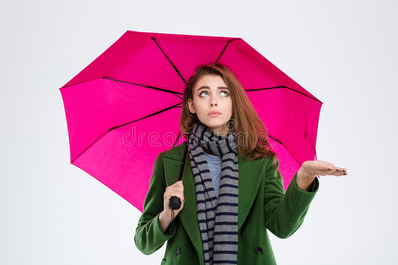 Woman in coat and scarf holding umbrella royalty free stock photos