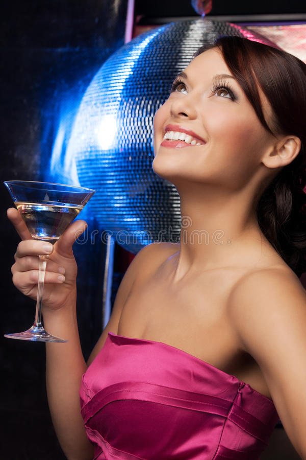 Woman with cocktail and disco ball. Beautiful woman in evening dress with cocktail and disco ball stock images