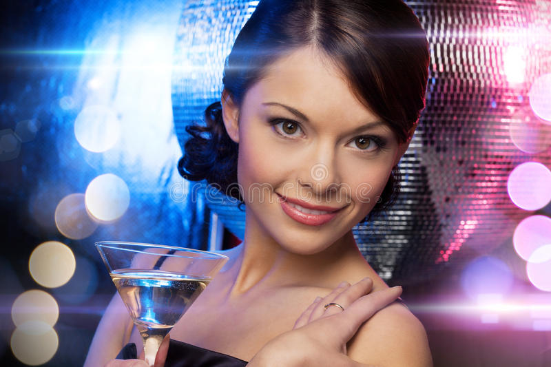 Woman with cocktail and disco ball. Luxury, vip, nightlife, party concept - beautiful woman in evening dress with cocktail and disco ball royalty free stock photo