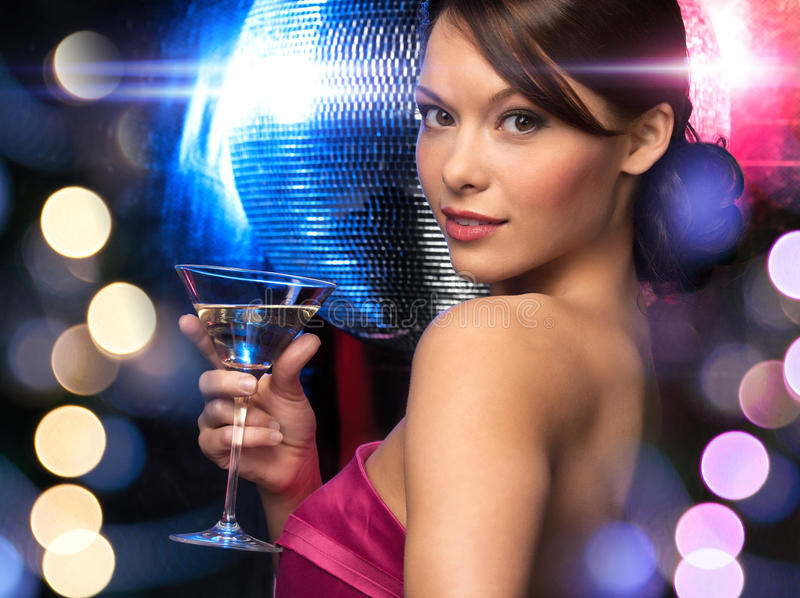 Woman with cocktail and disco ball stock photos