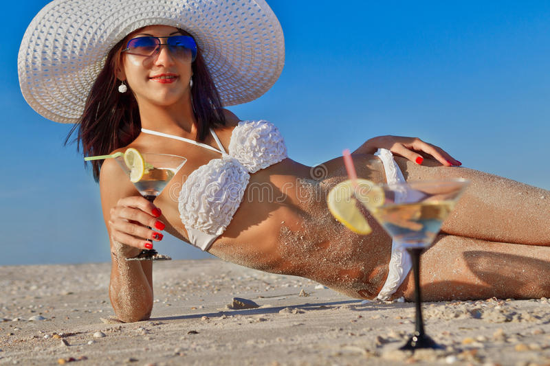 Woman with cocktail relaxing on beach stock photography