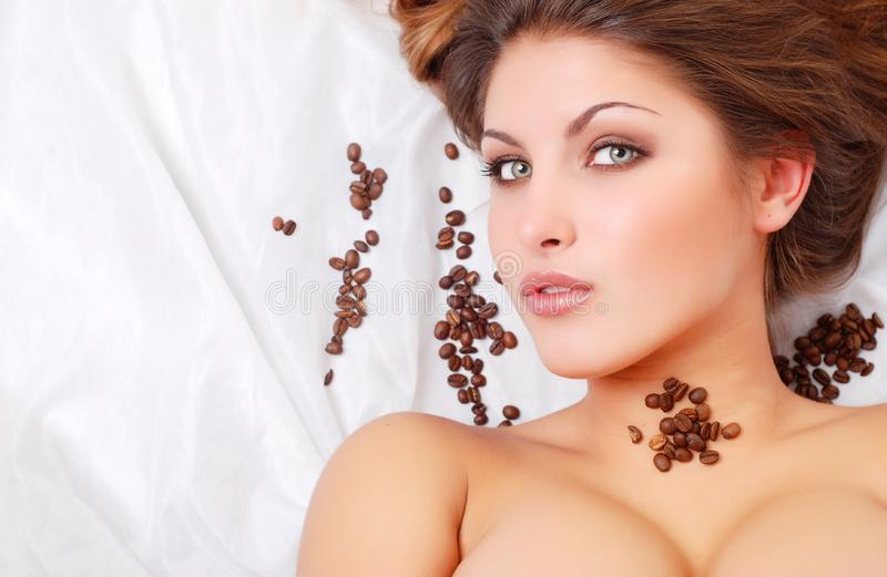 Woman with coffee beans royalty free stock images