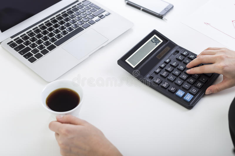 Download Woman With Coffee And A Calculator Stock Photo - Image: 83722746