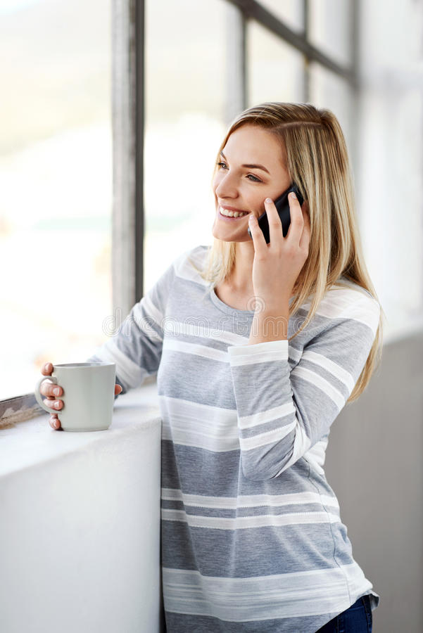 Woman coffee phone royalty free stock photography