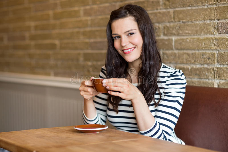 Woman in Coffee Shop Holding Cup stock images
