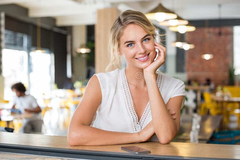 Woman at coffee shop royalty free stock image
